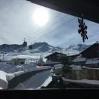 Window views of Pas de la Casa slopes from The Little Rock Cafe
