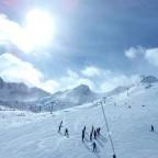 Ski school enjoying the slopes below